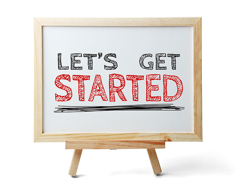 """Board with the text """"let's get started"""""""